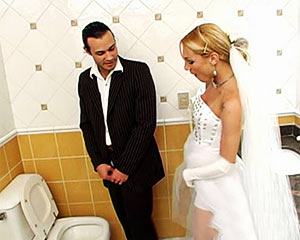 Shemale in a restroom with her husband just after wedding