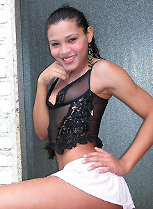 Latina shemale Giselle wearing a sheer black top