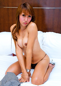 Ladyboy Bir posing on a bed